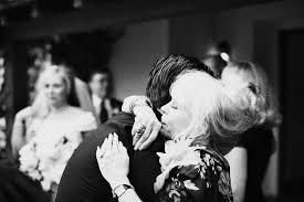 mom son wedding hug